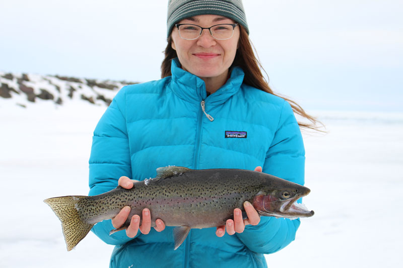 Patagonia's latest photo shoot on a frozen tundra ice fishing for rainbow trout in April.